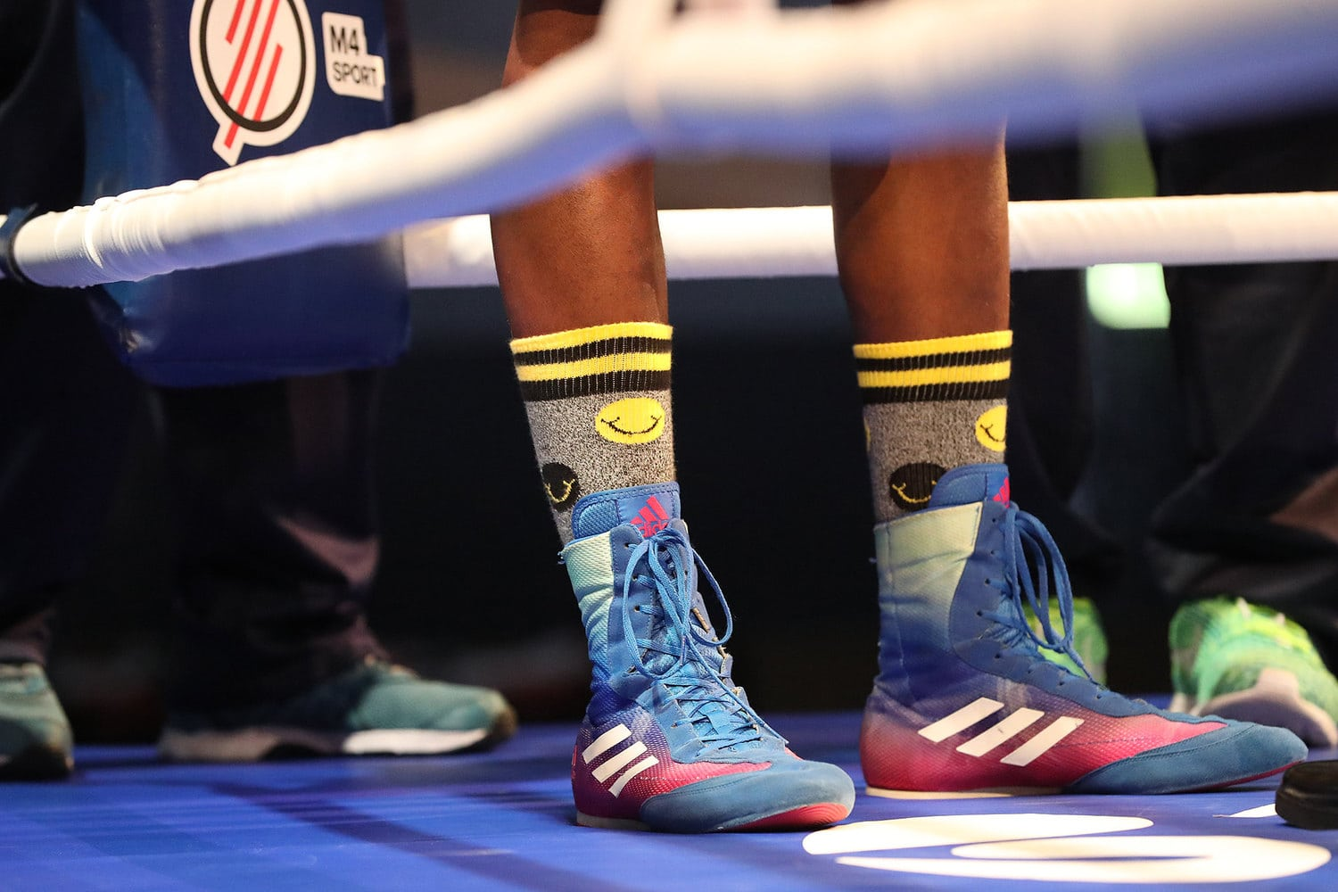 boxer wearing boxing shoes on the ring