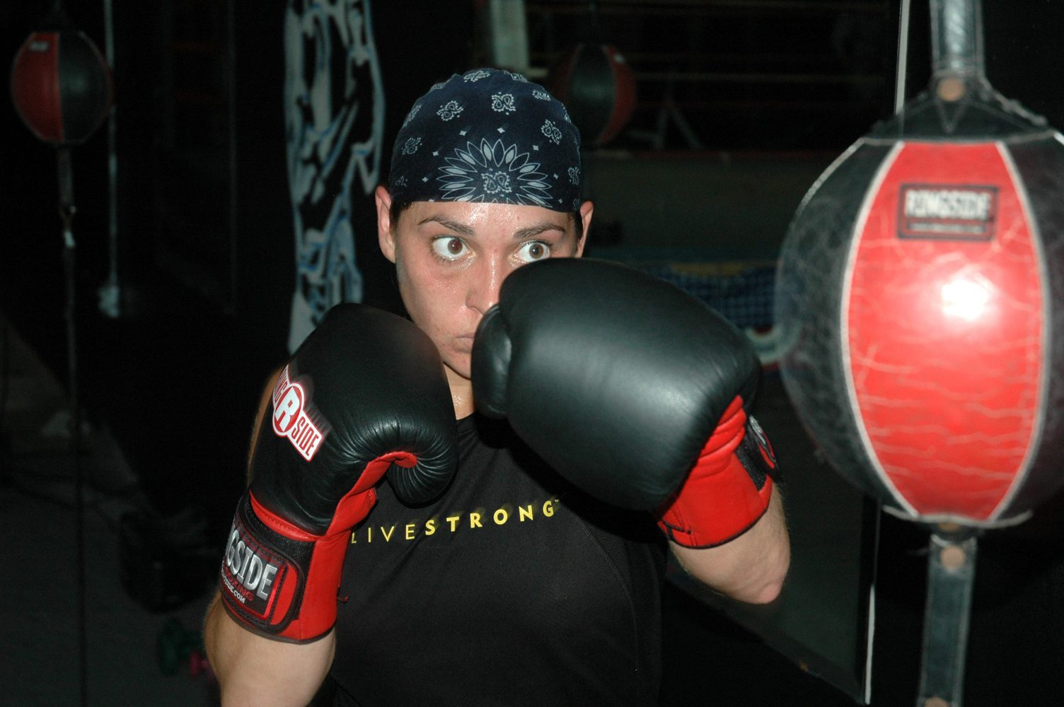 female athlete training on a double end bag