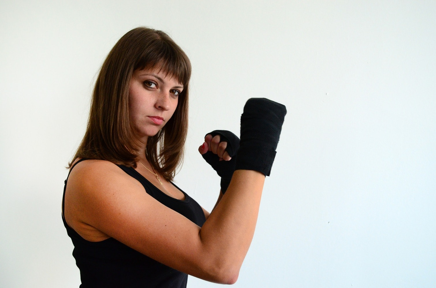 female boxer on a pose with handwraps