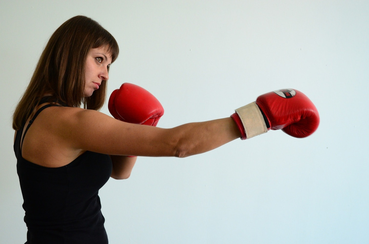 female boxer on a punching pose