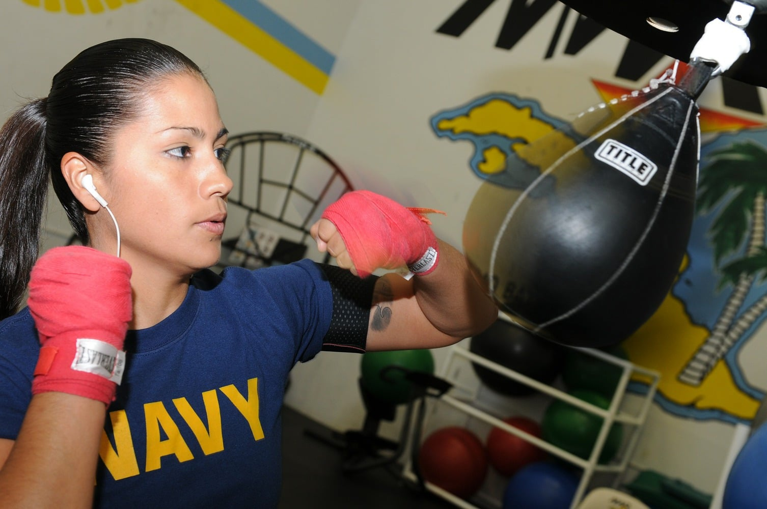 female boxer training on a speedbag