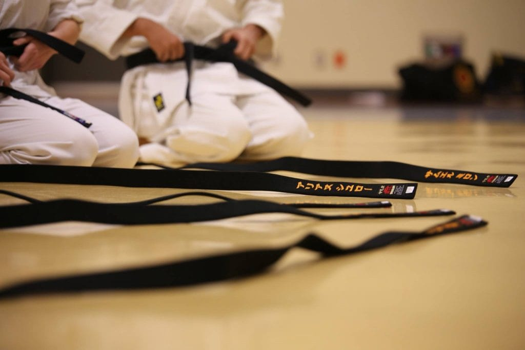 BJJ Gi belts laid on the floor - feature image