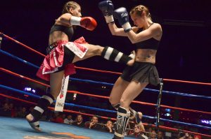 Women fighters wearing shin guards - feature image