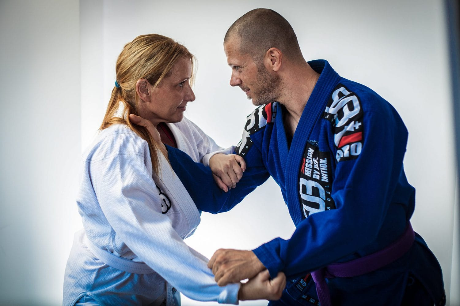 male and femaile BJJ fighters wearing Gi