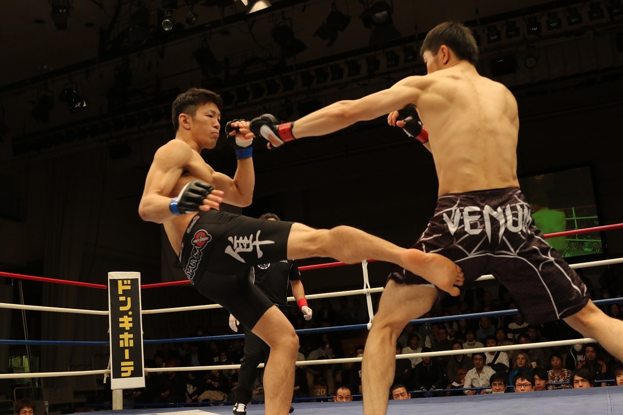 mma fighters in black shorts