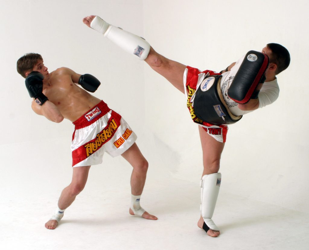 Muay Thai fighters in full gear - feature image